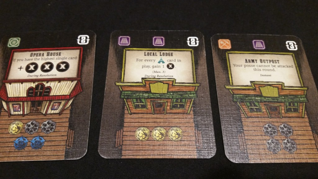 Building cards. Costs on the bottom, ability in the text, victory points and stocks on top