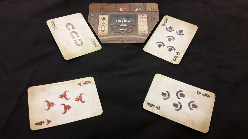 To determine who wins control over the Town Hall, for example, players with posse there compare the poker hands they make using their pocket card and the cards to the left and right of that location. In this case, since Hats are the high suit, the player on the right wins.