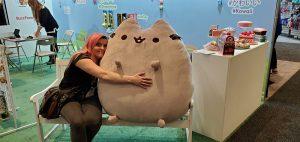 Jess and a giant stuffed Pusheen